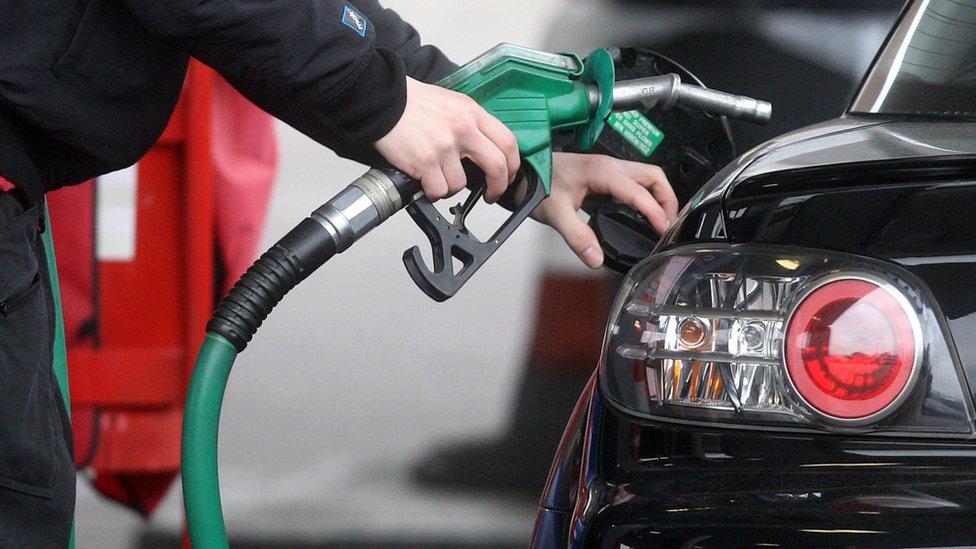 Man filling up at the pump