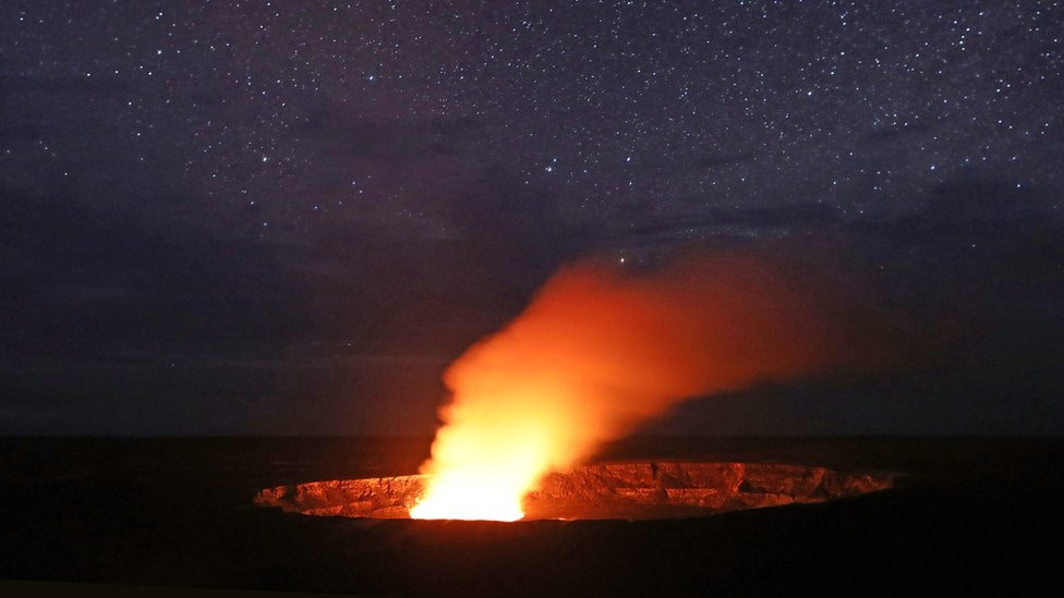 Stars shine above as a plume rises from the Halemaumau crater, at the Hawaii Volcanoes National Park on 9 May 2018 in Hawaii Volcanoes National Park, Hawaii