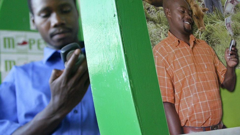 A man sending money through M-Pesa in Kenya's capital, Nairobi