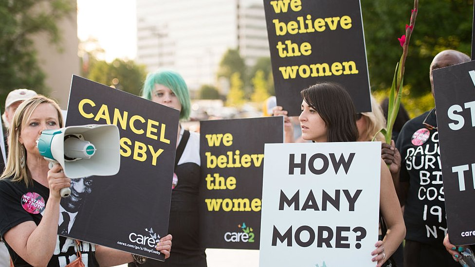Brandy Betts gathers with protestors outside of Bill Cosby's 'Far from Finished' Tour at Cobb Energy Performing Arts Center