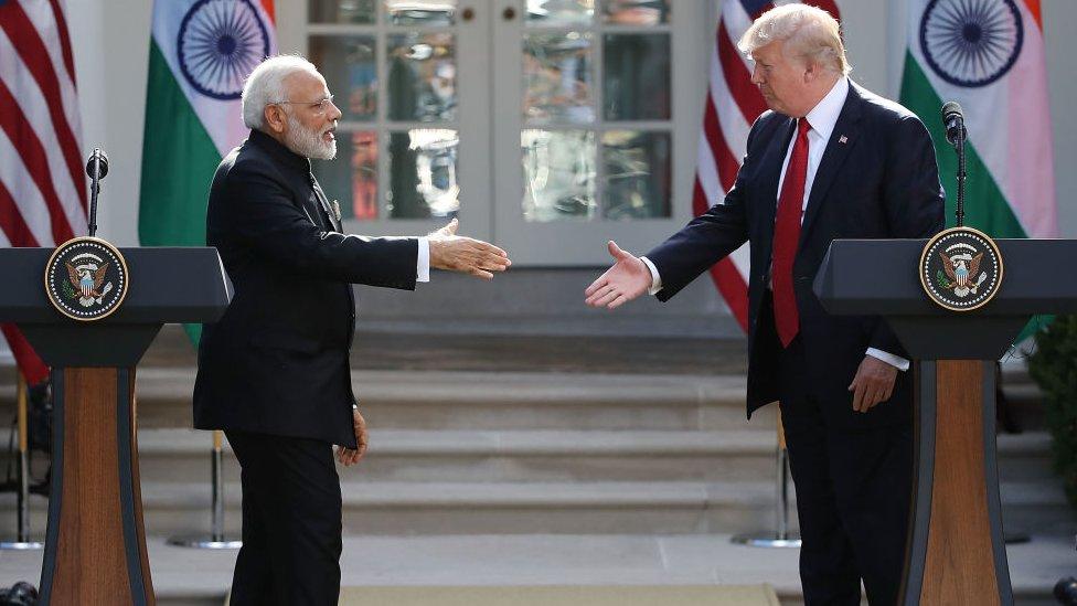 US President Donald Trump and Indian Prime Minister Narendra Modi shake hands