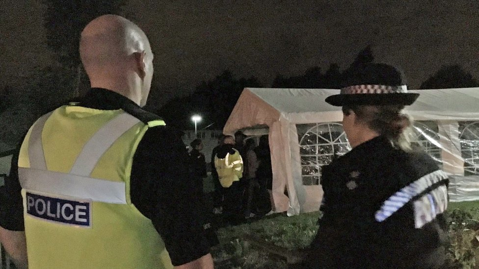 Police officers outside a marquee in Birmingham