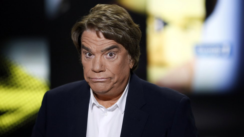Embattled tycoon Bernard Tapie poses before a broadcasted debate on French news channel iTele on July 10, 2013 in Paris