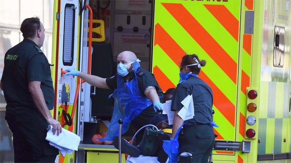 Coronavirus patient being helped into ambulance