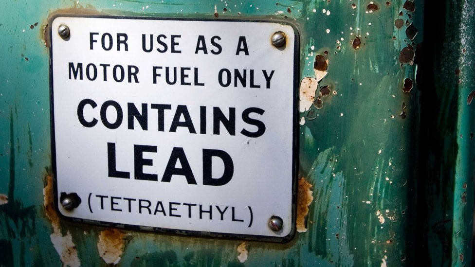 "Old petrol pump sign saying ""For use as a motor fuel only. Contains Lead (Tetraethyl)"