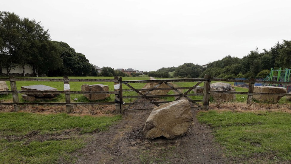 Playing fields at Grange Moor with boulders that travellers attempted to remove to gain access to the site