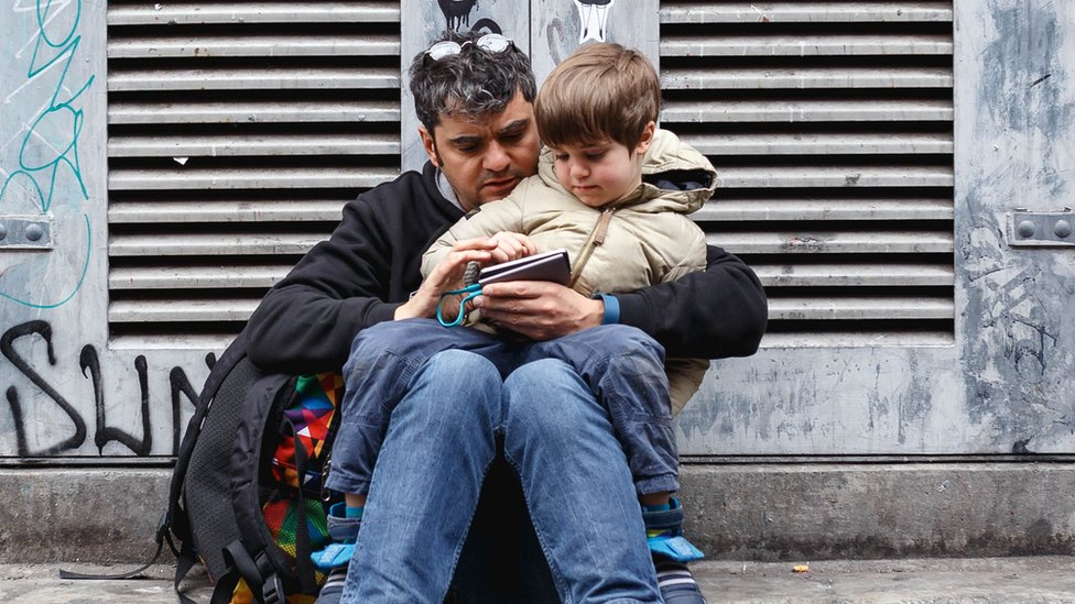 Man with son in lap