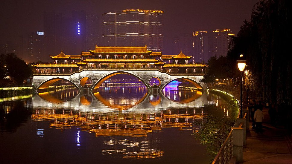 Illuminated Anshun Bridge over the Jin River at night in the provincial capital of Chengdu in Sichuan