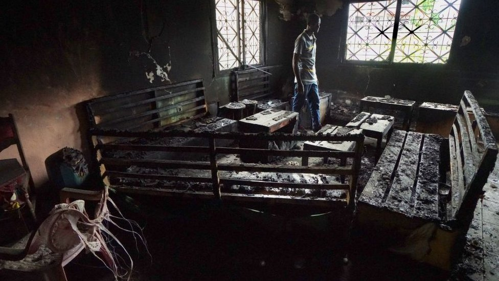 A local man walks thru a burnt-out restaurant on May 11, 2019 that was destroyed in fighting between armed Anglophone separatists and Cameroonian military forces in Buea,Cameroon