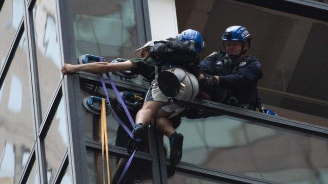 Police grab man climbing Trump Tower