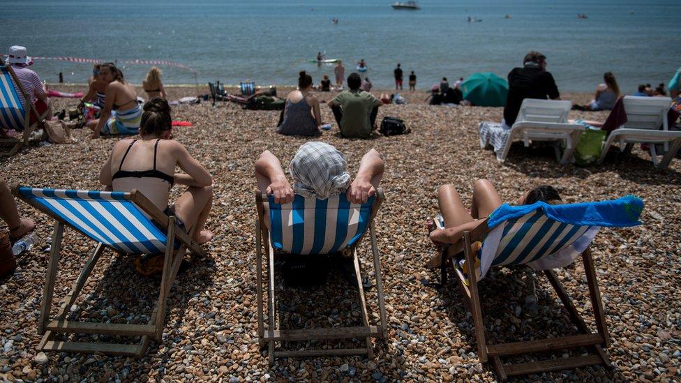People sunbathing in Brighton