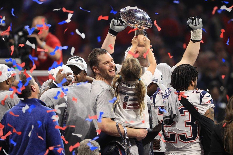 Players lift Super Bowl trophy