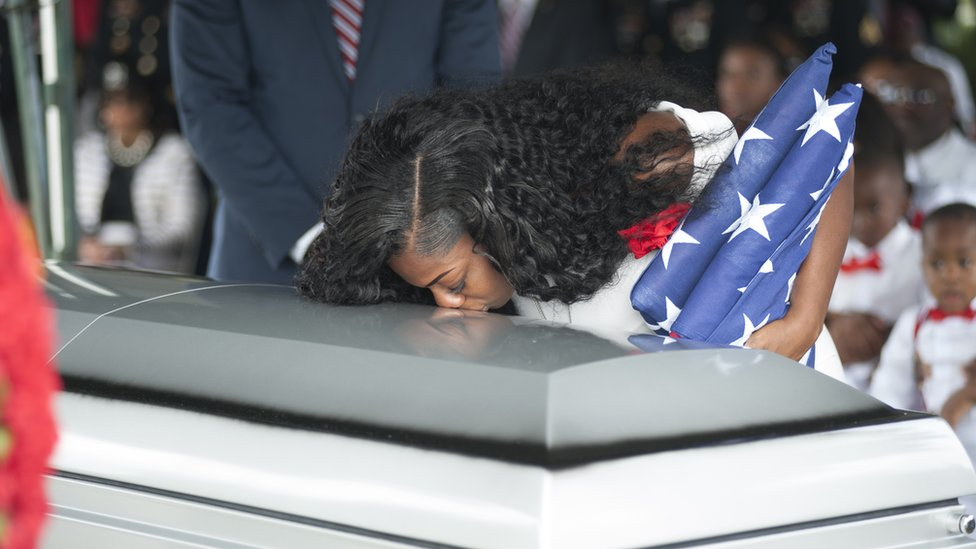 Myeshia Johnson kisses the casket of her husband Army Sgt La David Johnson during his burial service in Florida, after Sgt Johnson and three other US soldiers were killed in an ambush in Niger on 4 October 2017