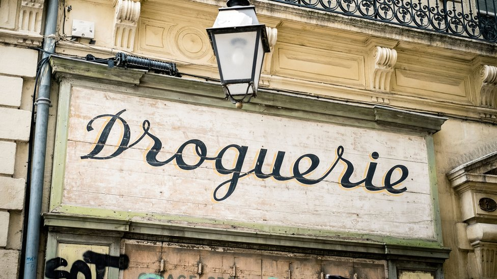 Droguerie signboard above old shop