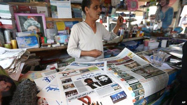 Newspaper seller in Afghanistan