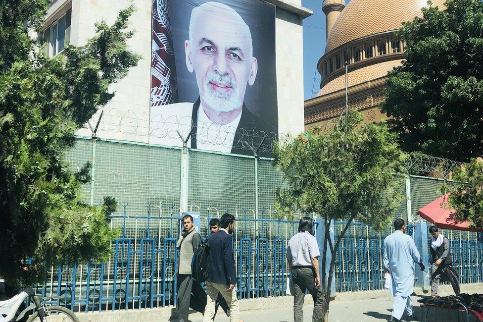 A poster of Ashraf Ghani
