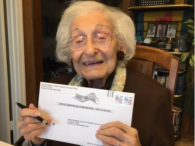 """Estelle L. Schultz, who was born two years before women had the right to vote, marked her absentee ballot for the first female president, Hillary Clinton."""