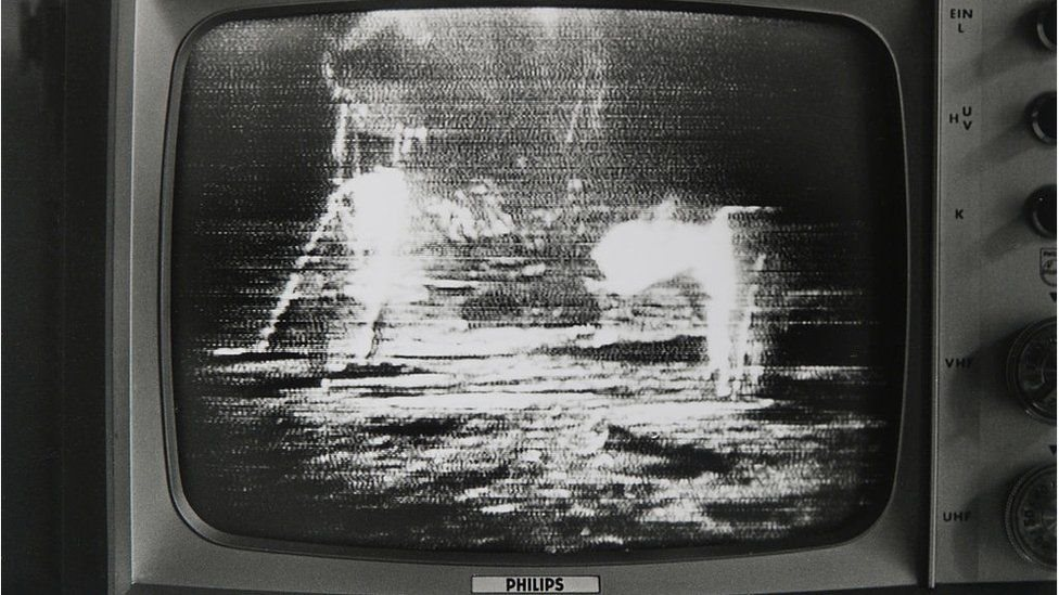 Landing on the moon seen from the TV at the time.