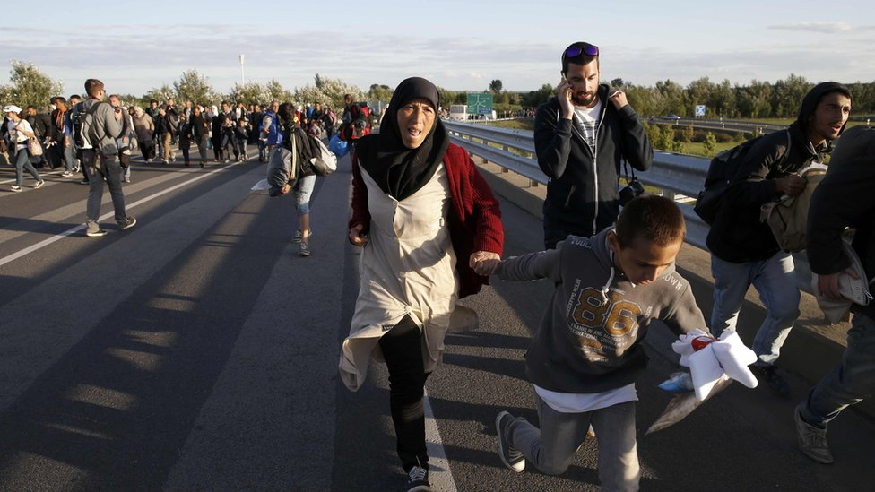 Migrants run along motorway to Budapest. 7 Sept 2015