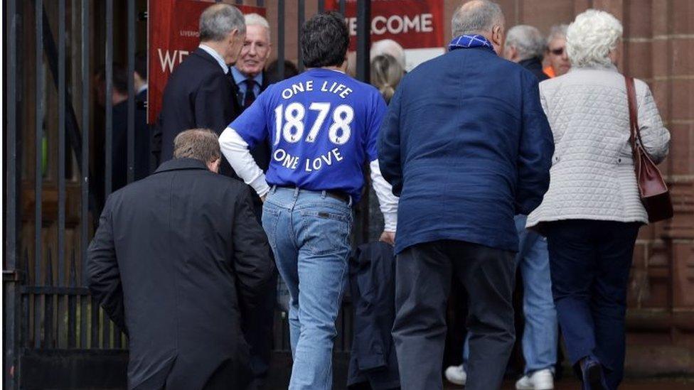 Fans enter cathedral