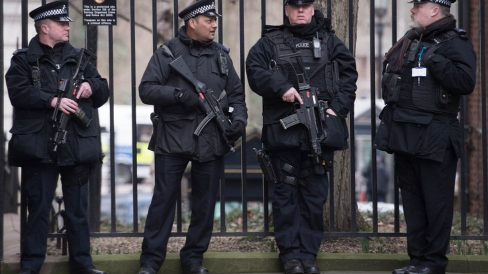armed police stand outside downing street in London