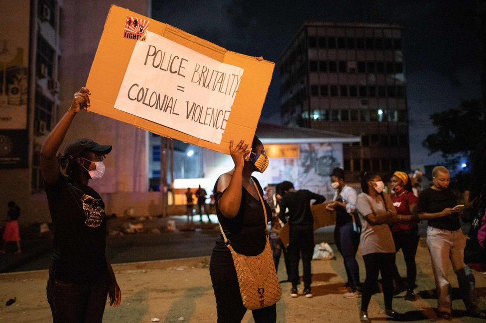 Activists hold a placard in Accra
