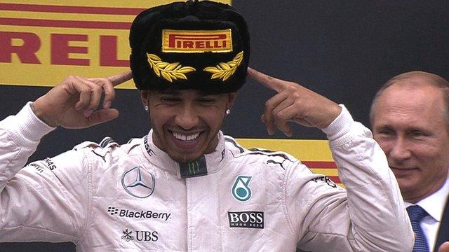 Mercedes' Lewis Hamilton and Vladimir Putin
