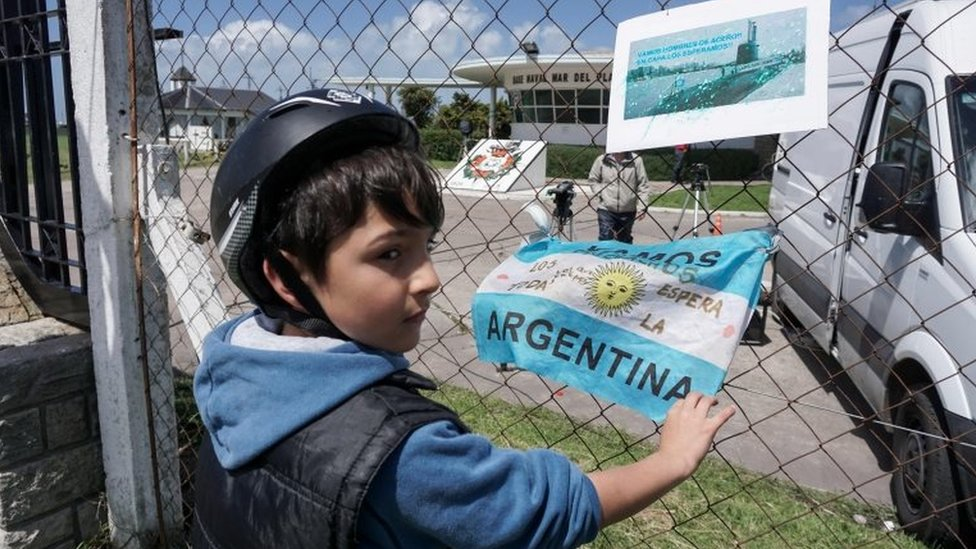 Banners and Argentine flags with message in support of submarine crew members are displayed outside Argentina's Navy base in Mar del Plata, on the Atlantic coast south of Buenos Aires, on November 19,
