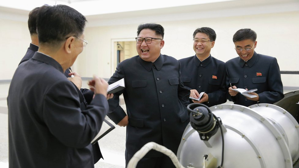 North Korean leader Kim Jong-un inspecting a bomb (undated photo released 3 September)
