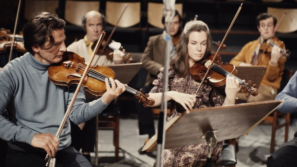English conductor and violinist Neville Marriner (left) playing with an ensemble, circa 1965.
