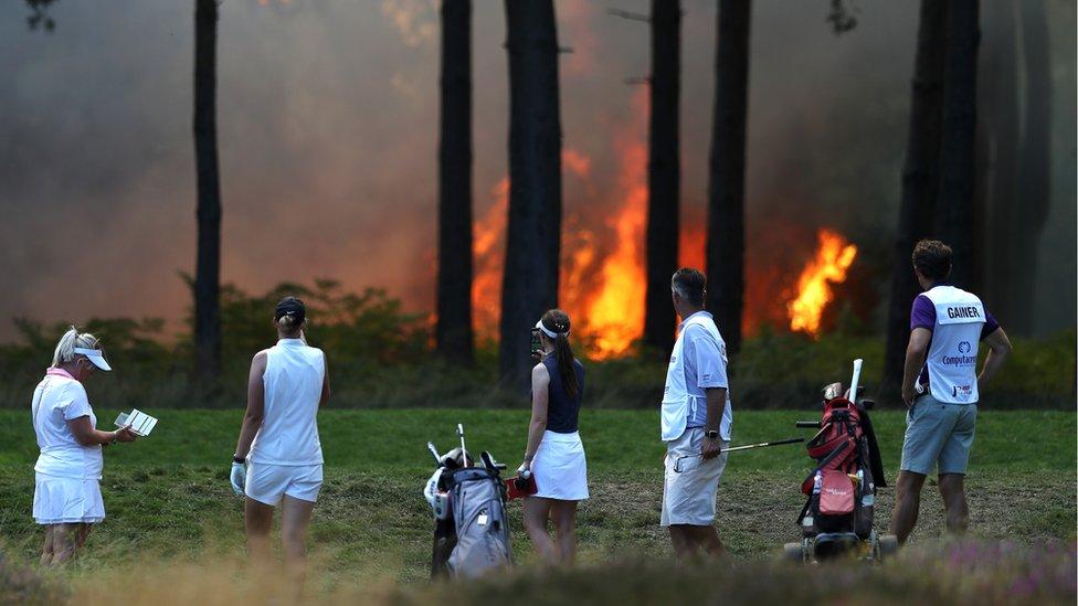 Golfers near the fire