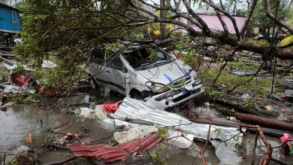 A car damaged by a tree is pictured after the passing of Hurricane Iota, in Puerto Cabezas, Nicaragua