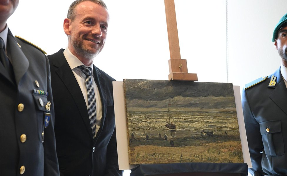 Axel Ruger, director of Amsterdam's Van Gogh Museum, stands next to the painting Seascape at Scheveningen (30 Sept)