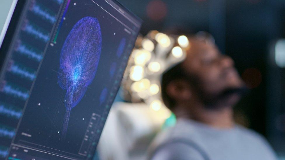 A man wearing a brain monitor
