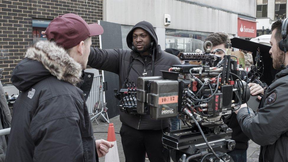 Rapman (centre) on the set of Blue Story