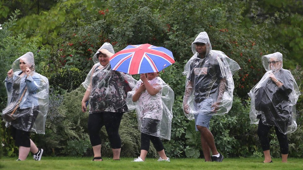 Visitors walk through the Kensington Palace gardens on the anniversary of Diana's death
