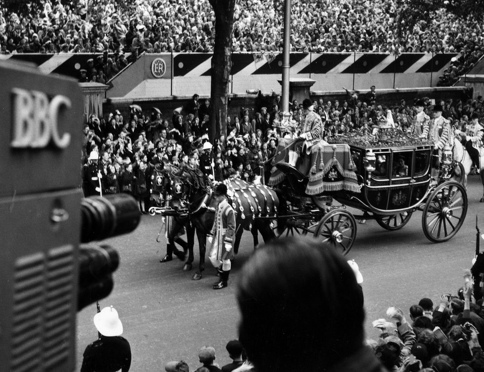 The carriage procession of H.M. Queen Elizabeth the Queen Mother and H.R.H. the Princess Margaret passing the television camera on the Victoria Embankment on the way to the Abbey. This image is taken from the Coronation of Her Majesty (H.M), Queen Elizabeth II (Queen Elizabeth The Second), June 2nd 1953.