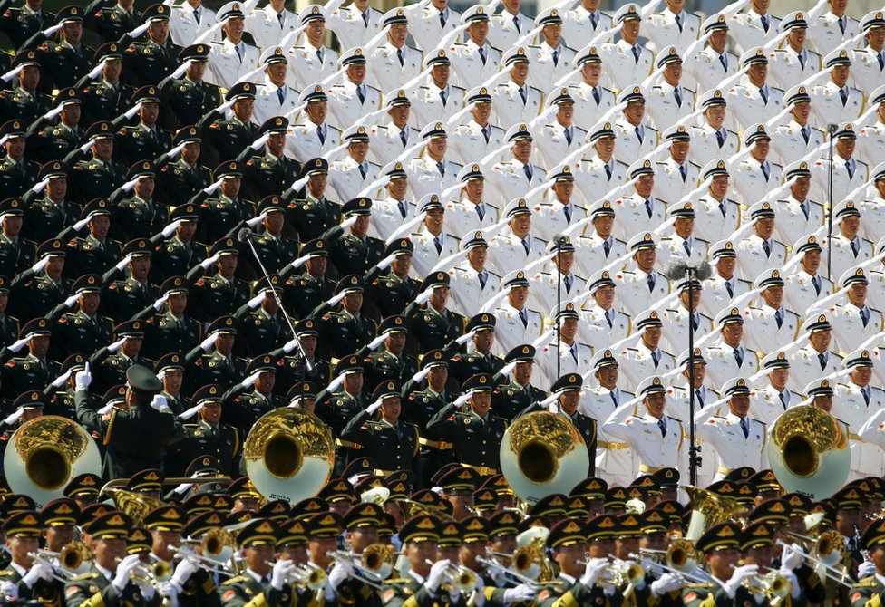 Military band sing and salute at the Tiananmen Square at the beginning of the military parade marking the 70th anniversary of the end of World War Two, in Beijing, China, 3 September 2015.