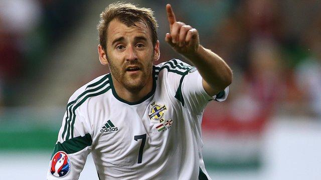 Niall McGinn celebrates scoring against Hungary