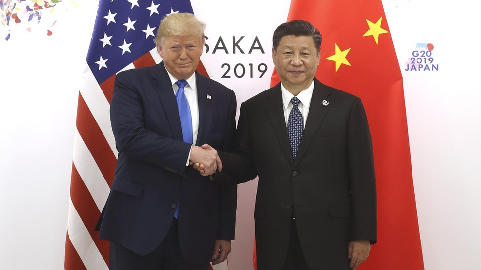 Chinese President Xi Jinping (R) shakes hands with US President Donald Trump before a bilateral meeting during the G20 Summit on June 29, 2019 in Osaka, Japan.