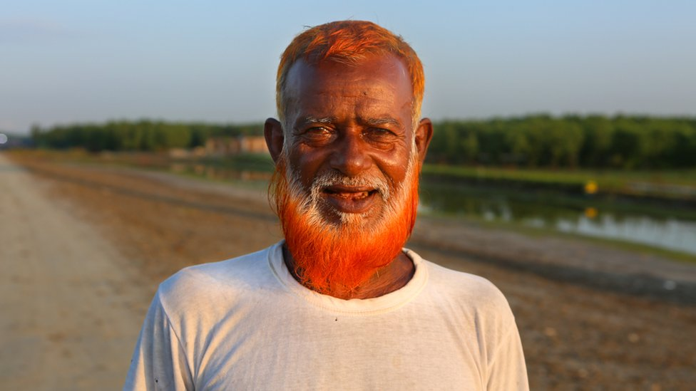 50-year-old cattle rancher Tajul Haq with his henna dyed beard