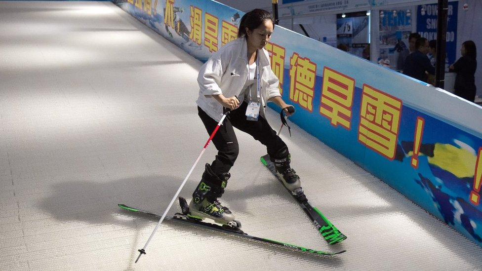 Young woman learning to ski in China