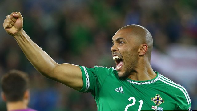 Former goalkeeper Josh Magennis showed his goal-scoring instincts as Northern Ireland booked their place at Euro 2016
