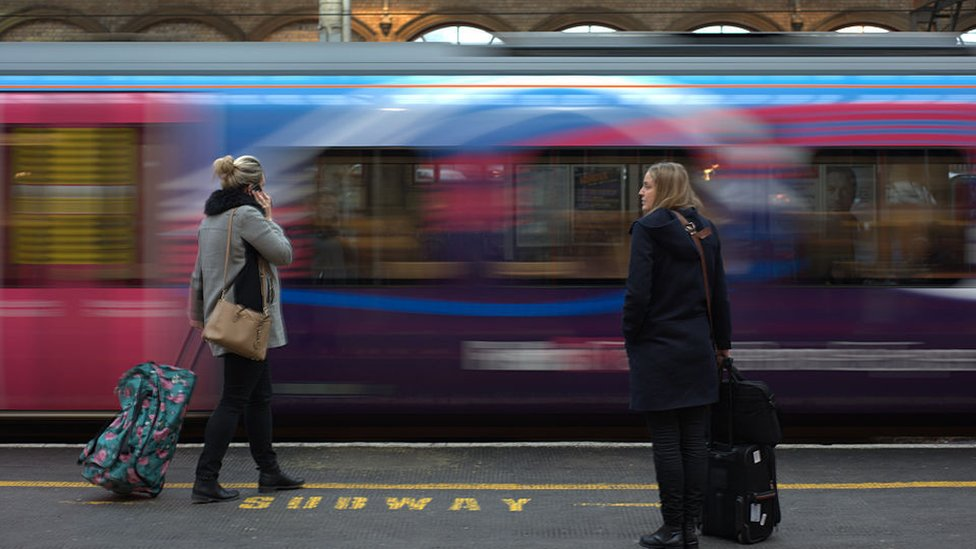 Passengers waiting at Preston railway station