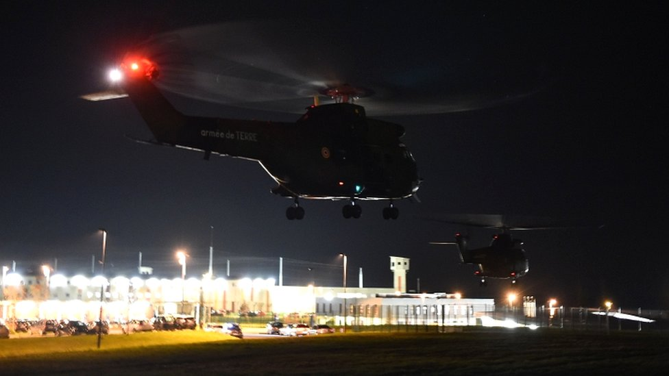 French army helicopters fly over the penitentiary center of Alençon, in Condé-sur-Sarthe, north-western France, on 5 March 2019