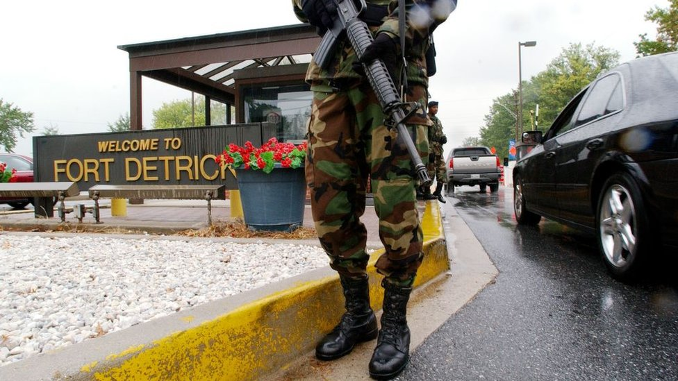 Military Personnel stand guard outside the US Army Medical Research Institute of Infectious Diseases at Fort Detrick