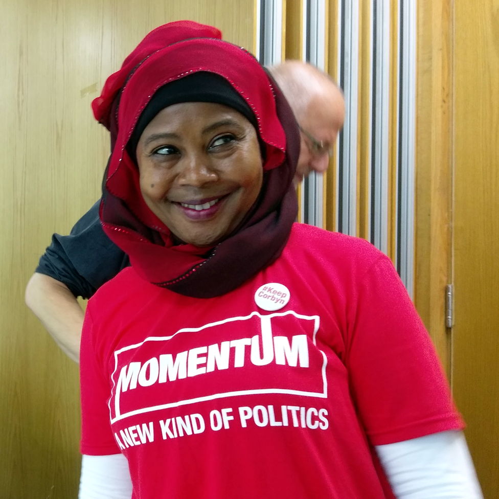A Jeremy Corbyn supporter wearing a Momentum t-shirt
