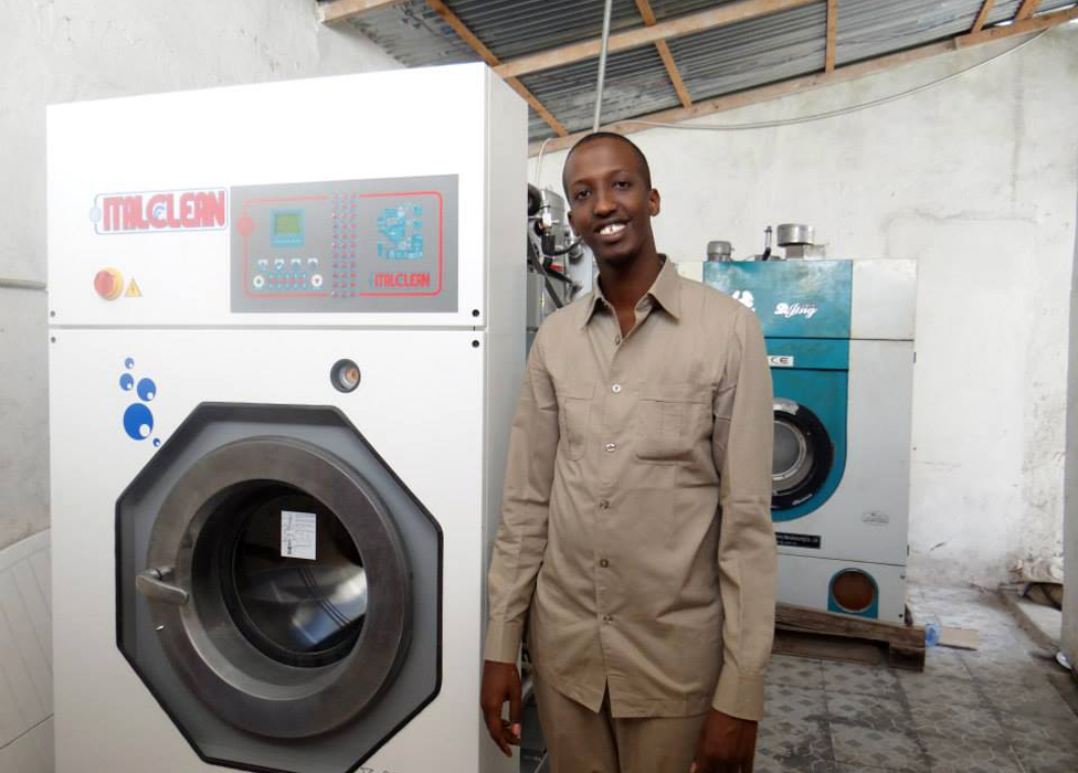 Mohamed Mahamoud Sheikh with a dry-cleaning machine