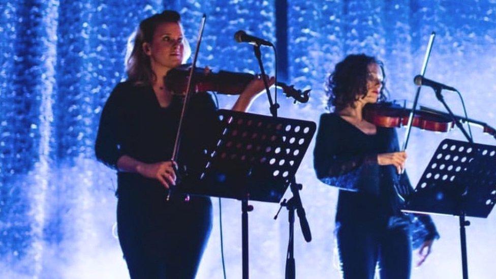 Katie Kresek (left) performing before the coronavirus pandemic