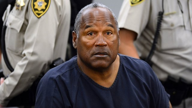 File photo - OJ Simpson sits during a break on the second day of an evidentiary hearing in Clark County District Court in Las Vegas